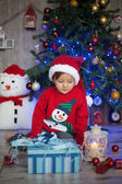 Boy, opening present on christmas — Stock Photo