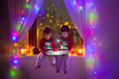 Two boys on the window reading — Stock Photo