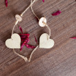 Wooden heart with rose leaves — Foto de Stock
