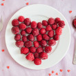 Raspberries in a shape of heart — Stock Photo #38833689