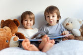 Two boys, reading a book, educating themselves — Stock Photo
