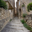 Narrow street in medieval town Gordes, southern France — Stock Photo #49313697