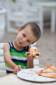 Adorable boy, eating pizza — Stock Photo