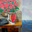 Stock Photo: Paintings in Atelier with Brushes and Basket Chair.