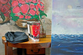 Paintings in Atelier with Brushes and Basket Chair. — Foto Stock
