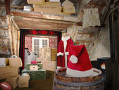 Santa Room with Christmas Gifts for World. — Stock Photo
