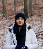 Seriouse Young Girl with Black Hair and Hat in Winter Forest — Stockfoto