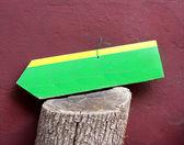 Travel Sign on Bole with Burgundy Wall — Stock Photo