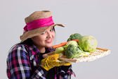 Woman Gardener in Leghorn Holds a Tray Full of Vegetables — Stock Photo