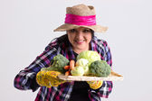Garden Woman in Leghorn Holds a Tray Full of Vegetables — Stock Photo