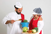 Handsome Italian Chief cook and Cooky with Tray of Vegetables and Blu — Stock Photo