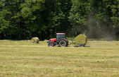 Agricultural Tractor on Hayfield — Stock Photo