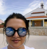 Woman Face with Sky Reflection in Sunglasses — Стоковое фото