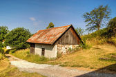 Lonely Aged House in Mountains  — Stock Photo