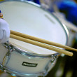 Female hand with drum sticks — Stock Photo