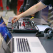 DJ with mixer is working — Stock Photo