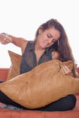 Angry woman hits the pillow — Stock Photo
