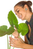 Women maintain plant — Stockfoto