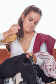 Girl tailor sewing fashion materials — Stock Photo