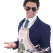 Adult man with an apron holding a cooking pot — Stock Photo #39878285