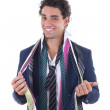 Happy man with lot of ties around his neck — Stock Photo #39879077