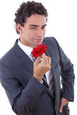 Seducer with rose — Stock Photo