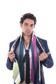 Undecided man with lot of ties around his neck — Stock Photo