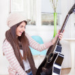 Stock Photo: Girl gets guitar as present