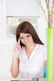 Girl on the phone at home — Stock Photo