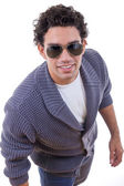 Attractive man in sweater with sunglasses — Stock Photo
