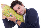 Man with a pillow dreaming while and resting peacefully with ser — Stock Photo