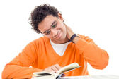 Man with neck pain reading book — Stockfoto