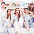 Divided friends watching game cheering for different teams — Stock Photo #40967927