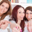 Girls pointing fingers at you choosing with a smile — Stock Photo