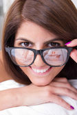 Beautiful woman with glasses smiling — Stock Photo