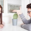 Angry man pointing at woman sitting across the table — Stock Photo #41353421