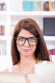 Female geek student with glasses — Stock Photo