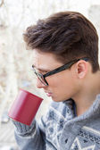 Man with glasses drinking coffee — Stock Photo