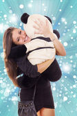 Smiling thrilled business woman hugging teddy bear — Stock Photo