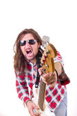 Man with face expression pointed his  guitar at the camera — Foto de Stock