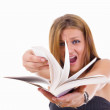 Stock Photo: Angry female student flipping book