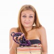 Confused girl takes out jewelery from jewelry box — Stock Photo #41782375