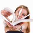 Stock Photo: Happy female student flipping book