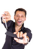 Male hairdresser with scissors and comb — Stock Photo