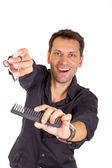 Smiling hairdresser working with scissors and comb — Stock fotografie