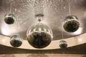Shiny disco balls on the ceiling in the hall — Stock Photo
