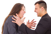 Angry couple fighting wanting to strange each other — Stock Photo