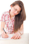 Student girl wearing glasses with pen and notebook — Stock Photo