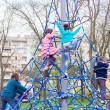Children climb on the jungle gym at the park — Foto Stock