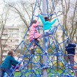 Children climb on the jungle gym at the park — Stok fotoğraf